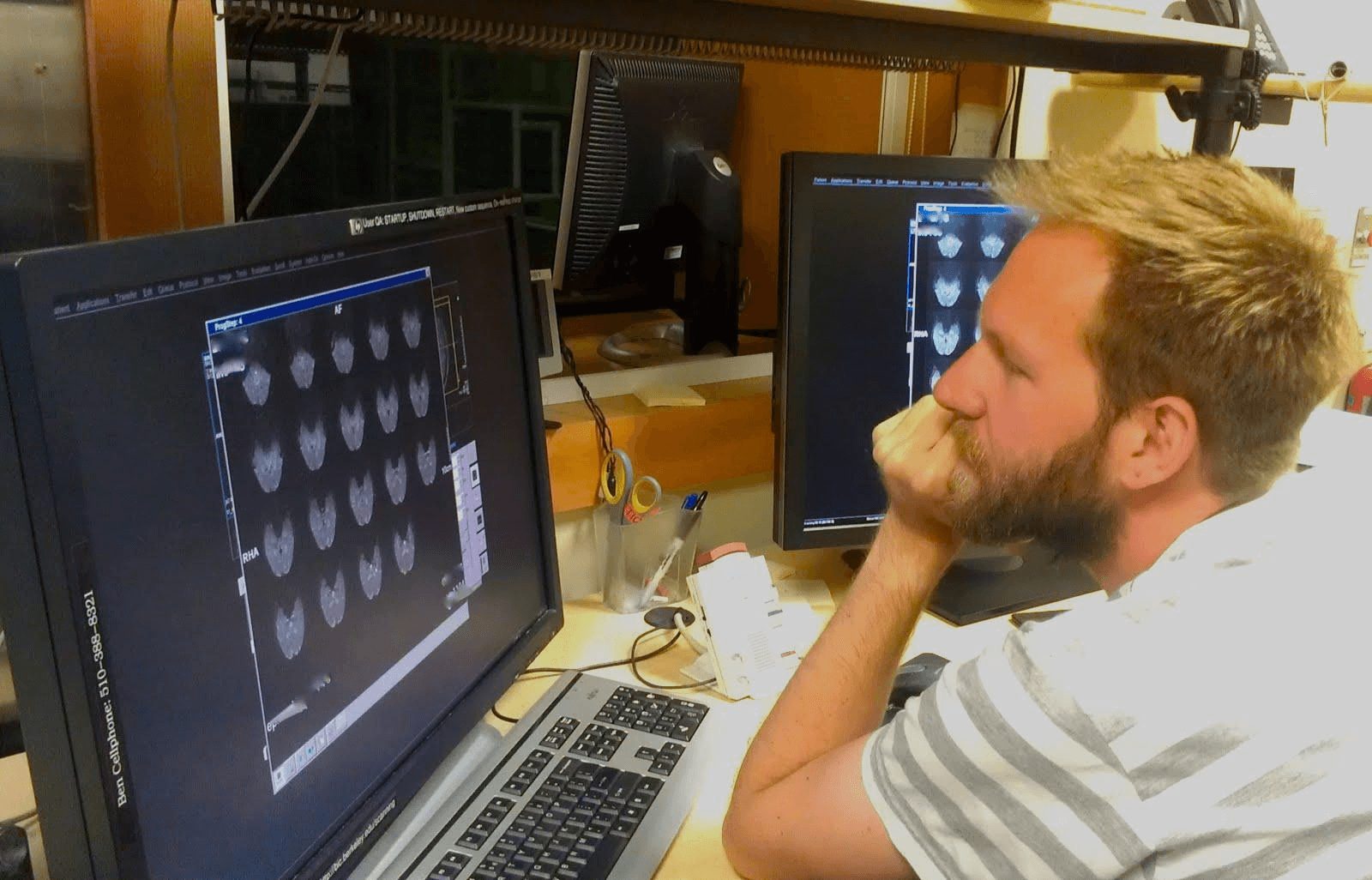 Shawn Marks, a graduate student in the Jagust lab, inspects his fMRI data collected in the BIC.