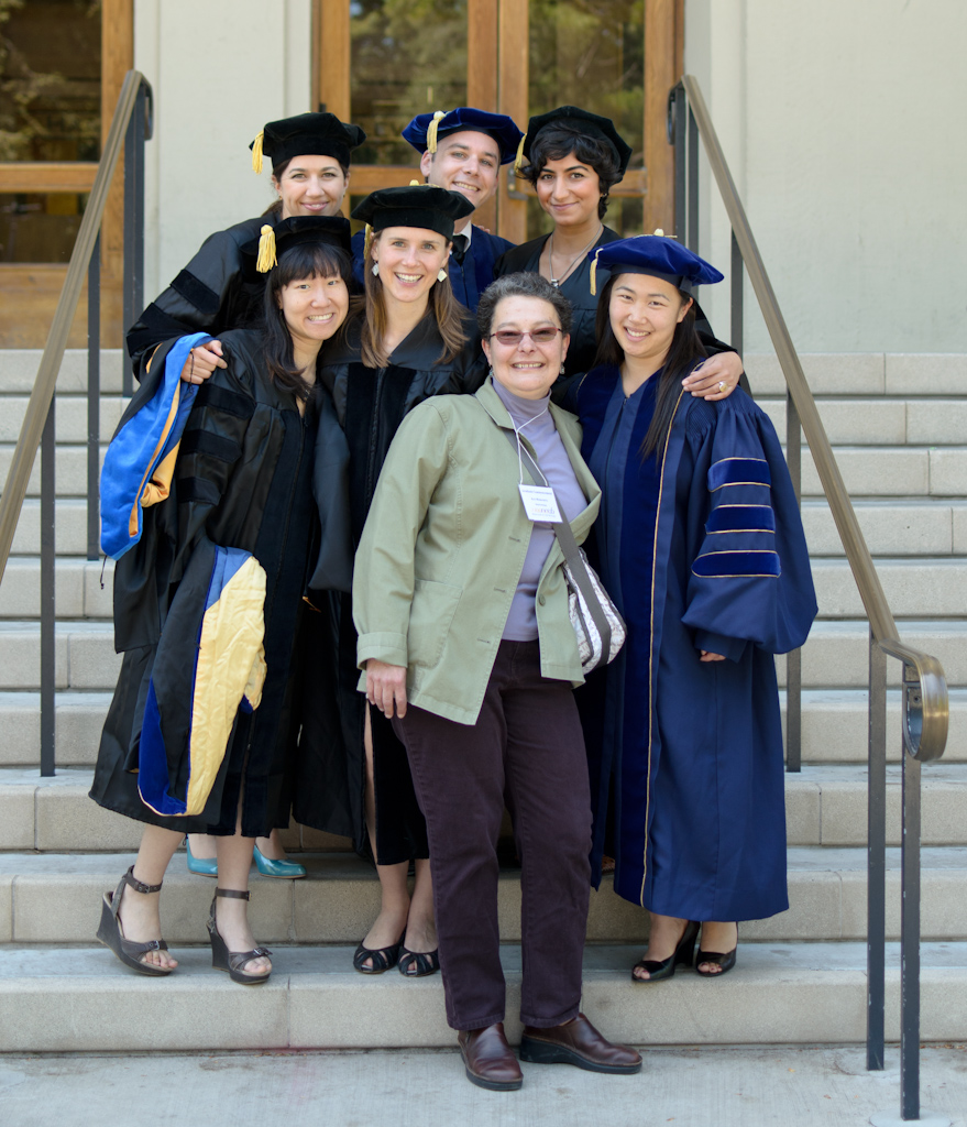 Köver after the PhD commencement ceremony with fellow graduates and much loved former administrator of the Helen Wills Neuroscience Institute, Kati Markowitz.